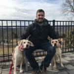 Photo of Michael Forzano with his two dogs