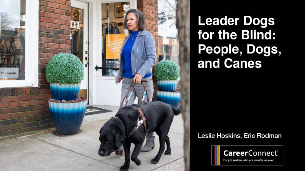 Professional woman walking outdoors with a black lab guide dog